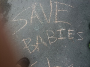 Drawn on sidewalk outside Planned Parenthood by a 6-year old girl.